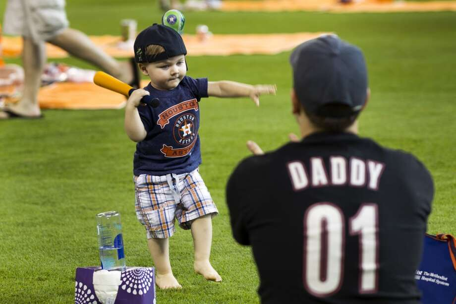 Holden Fariris plays baseball with his dad, Houston. Photo: Brett Coomer, Houston Chronicle