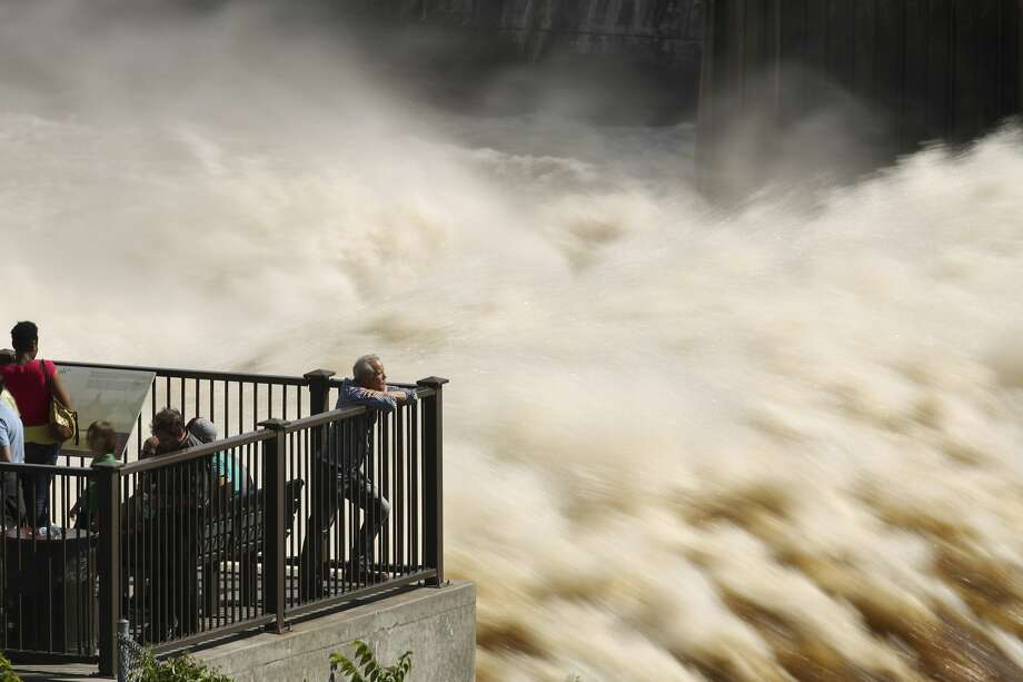 Big gusher: A crowd gathers to view the turbulent water flow at St. Anthony Falls from the observation 