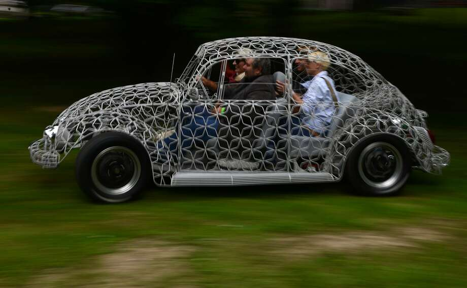 """See-through Bug:A wire-bodied Orion VW Beetle putts around at the   """"Legendy"""" Motoring Festival in Prague. Photo: Michal Cizek, AFP/Getty Images"""