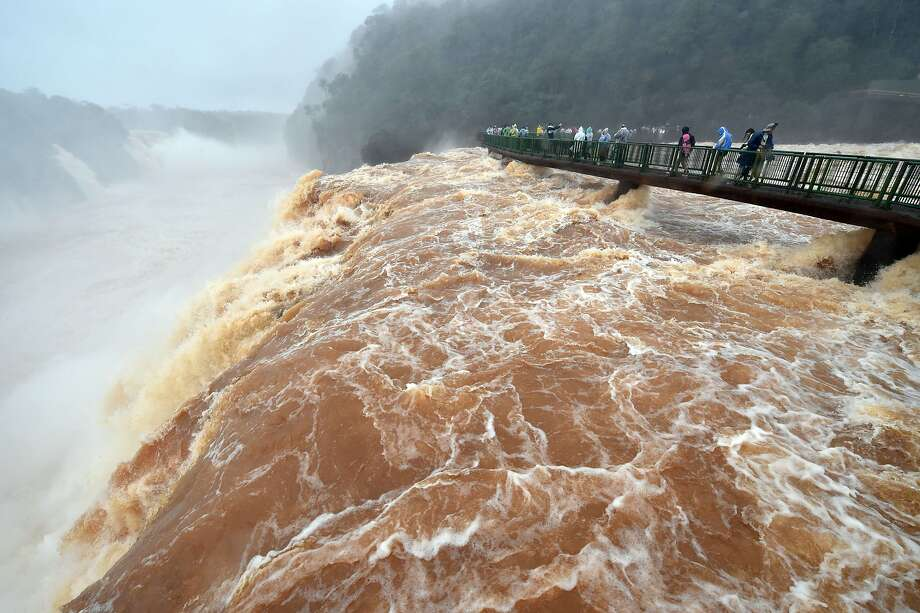 Even bigger gusher: Park officials have reopened the observation bridge over Iguazu Falls in Foz do Iguacu, Brazil. The platform was closed last week because of record-high flows on the Parana River. Photo: Jung Yeon-je, AFP/Getty Images