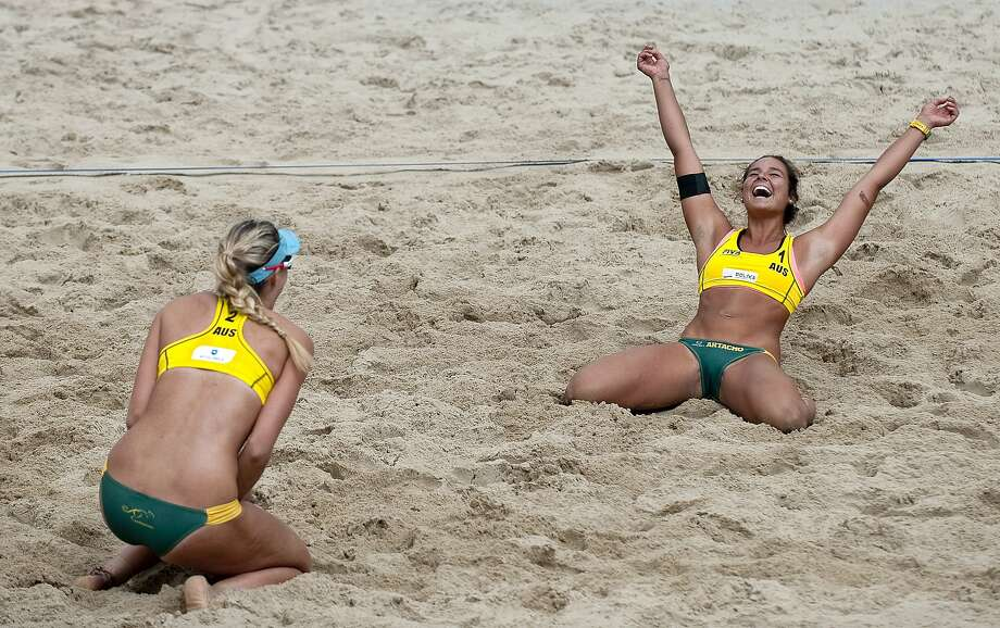Gold to the Aussies! Mariafe Artacho (right) and Nicole Laird of Australia celebrate their victory in the women's beach volley ball final during the FIVB Under 23 World Championships in Myslowice, Poland. Photo: Adam Nurkiewicz, Getty Images