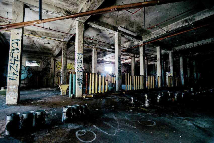 Industrial decay abounds within the former Fisher Flour Mill, photographed Thursday, June 5, 2014, near 16th Avenue Southwest and Southwest Lander Street on man-made Harbor Island in Seattle, Wash. The mill's opening on June 1, 1911, was coordinated as part of the city's