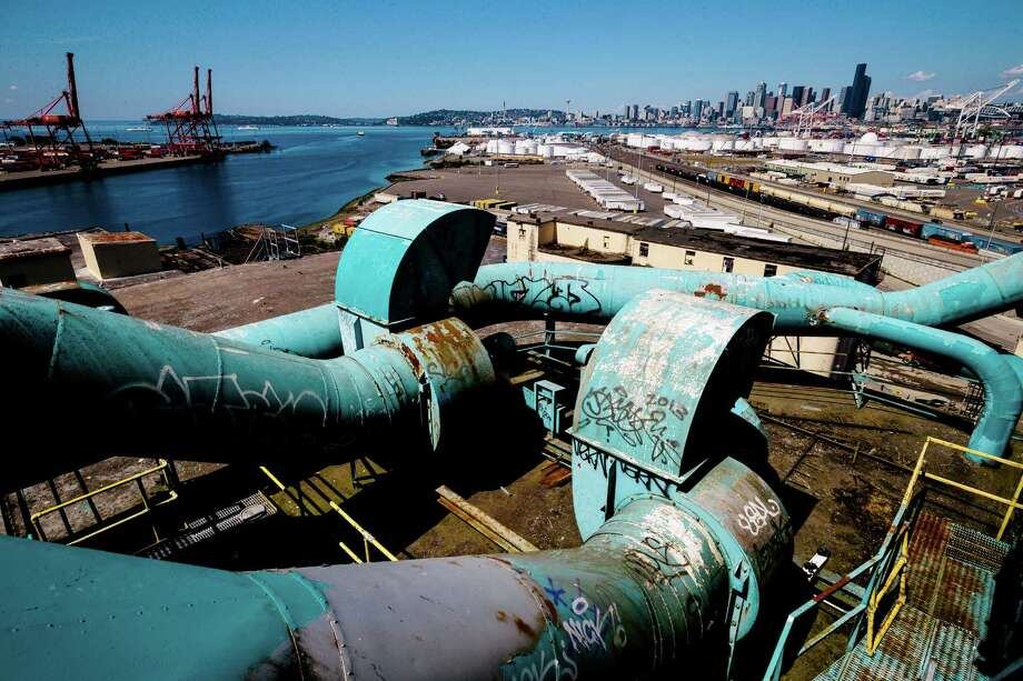 "Expansive skyline views of Seattle from the roof of the former Fisher Flour Mill, photographed Thursday, June 5, 2014, near 16th Avenue Southwest and Southwest Lander Street on man-made Harbor Island in Seattle, Wash. The mill's opening on June 1, 1911, was coordinated as part of the city's ""Progress and Prosperity Day,"" organized by then-Mayor George W. Dilling. Photo: JORDAN STEAD, SEATTLEPI.COM / SEATTLEPI.COM"