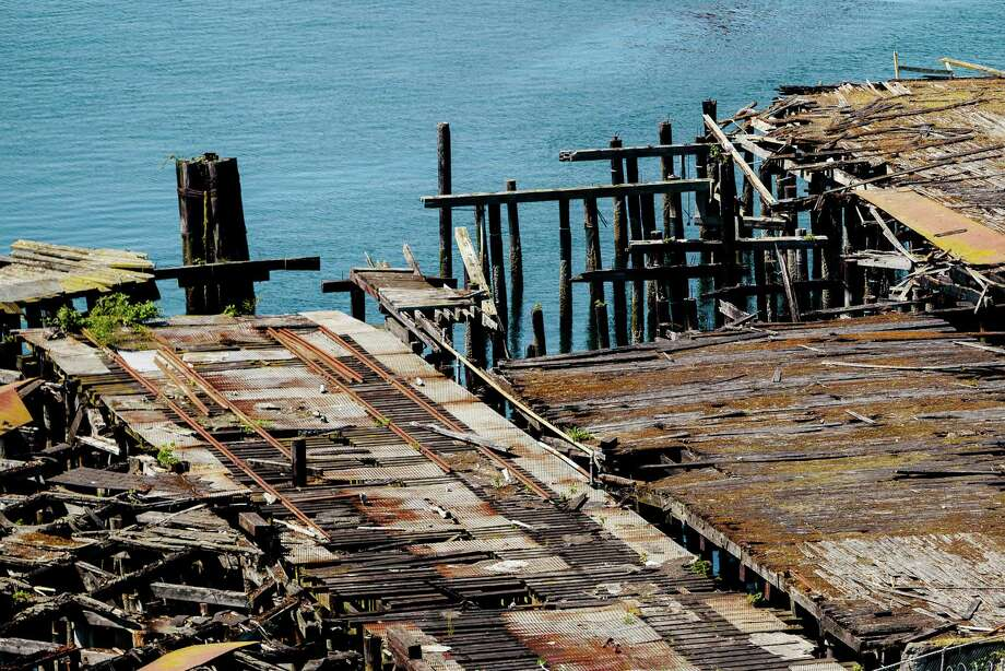 """A massive, rotting dock is slowly reclaimed by Puget Sound outside of the former Fisher Flour Mill, photographed Thursday, June 5, 2014, near 16th Avenue Southwest and Southwest Lander Street on man-made Harbor Island in Seattle, Wash. The mill's opening on June 1, 1911, was coordinated as part of the city's """"Progress and Prosperity Day,"""" organized by then-Mayor George W. Dilling. Photo: JORDAN STEAD, SEATTLEPI.COM / SEATTLEPI.COM"""