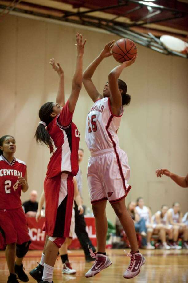 Central's  Savannah Brown guards Greenwich High girls basketball player Tori Dobson Monday Feb. 15, 2010. Photo: Douglas Healey, Douglas Healey/For Greenwich Tim / Greenwich Time