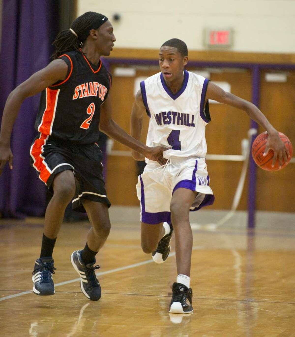 Westhill's Tim Simmons, right, and Stamford's 2, left, during an FCIAC boys basketball game at Westhill High School in Stamford, Conn. on Monday, Feb. 15, 2010. Stamford High School defeated Westhill High School 45-43.
