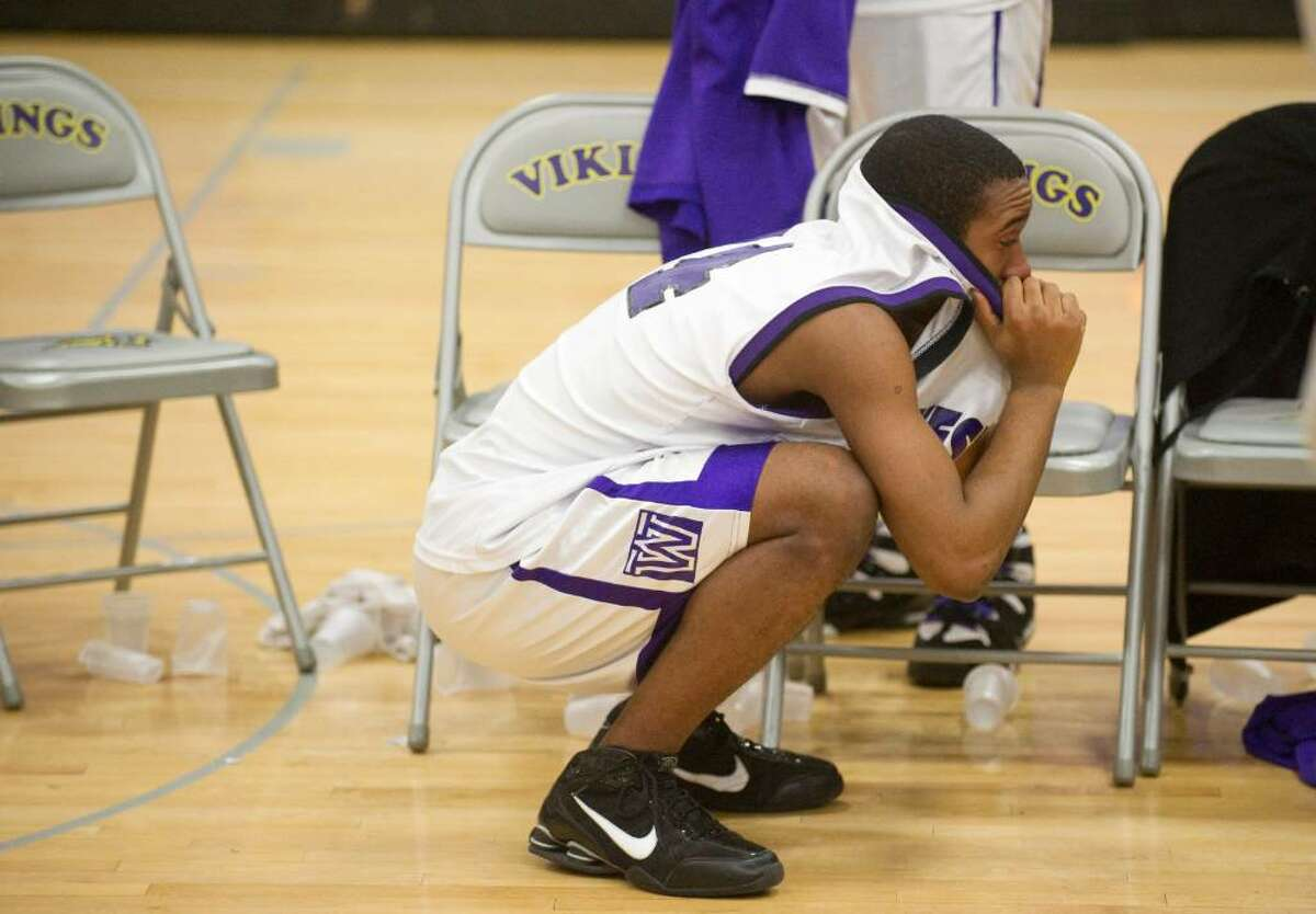 A Westhill High School player reacts to losing to Stamford High School during an FCIAC boys basketball game at Westhill High School in Stamford, Conn. on Monday, Feb. 15, 2010. Stamford High School defeated Westhill High School 45-43.