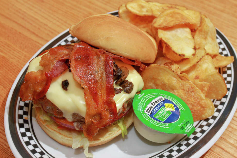 A Lubeburger at Quaker Steak & Lube, a chain of gas stationed-themed restaurant and bars, that is opening its first Houston-area location on I-45 in League City. Photo: Gary Fountain, For The Chronicle / Copyright 2014 by Gary Fountain