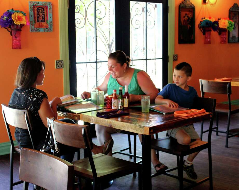 From left to right, Samantha Haldeman, Debbie LaFleche and Caleb LaFleche, 5, of Glenville order lunch at the new Mexican Radio restaurant on Monday, June 16, 2014, in Schenectady N.Y. (Selby Smith / Special to the Times Union) Photo: Selby Smith / 00027368A
