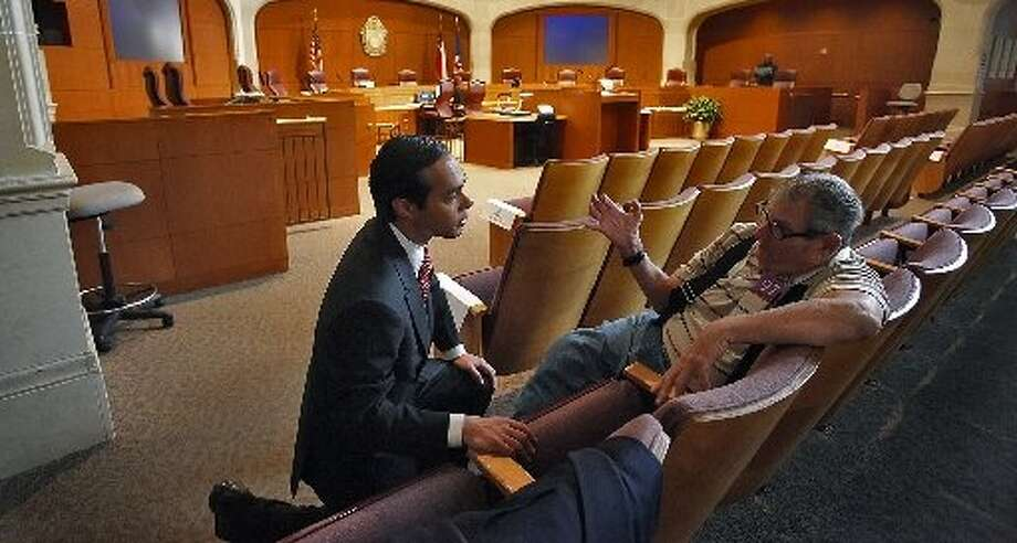 The City Council should not overlook its strongest candidate to replace Mayor Julián Castro — shown talking with a constituent in 2009 — just because that person  may seek the office in May. The future of San Antonio is too important. Photo: Express-News File Photo