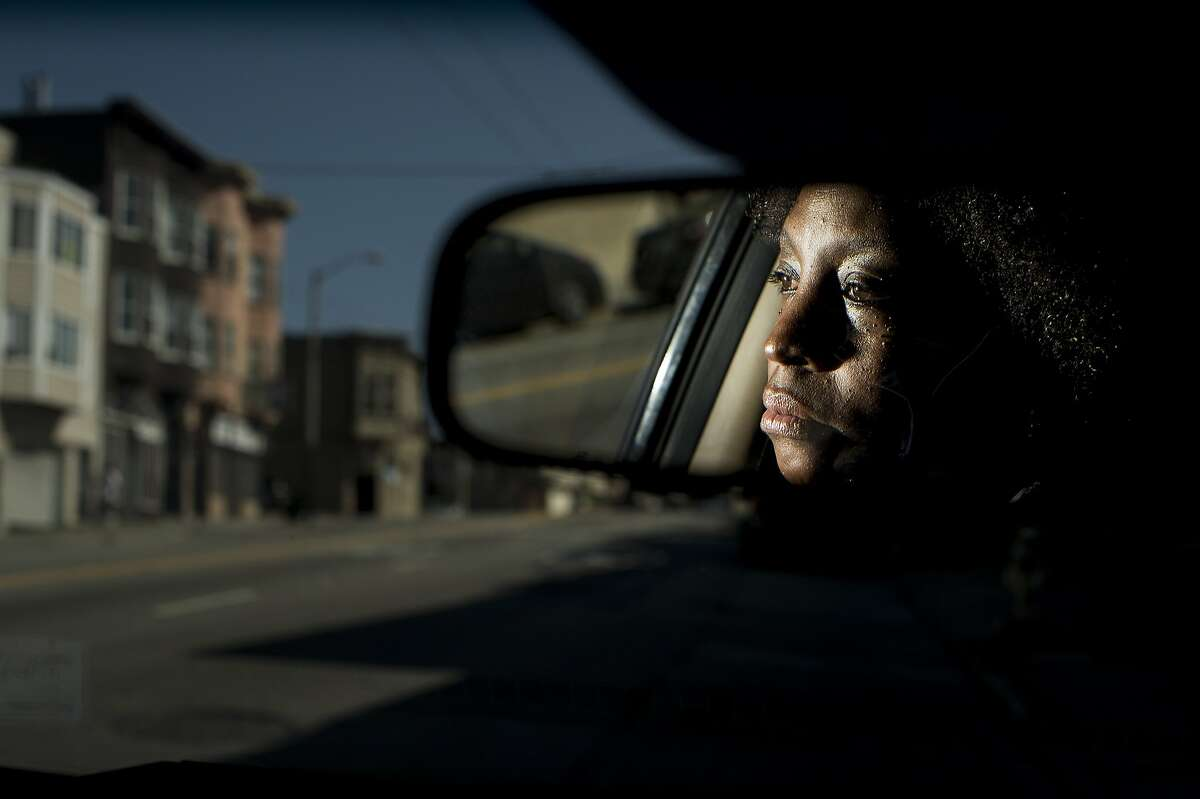 Denise Green looks out the window of her car while parked near Mission St. and Highland Ave. on Thursday, May 29, 2014, in San Francisco. At the same location in 2009, a license plate scanner mistakenly identified Green's Lexus as stolen leading police officers to hold Green at gunpoint until they realized the scanner's error.