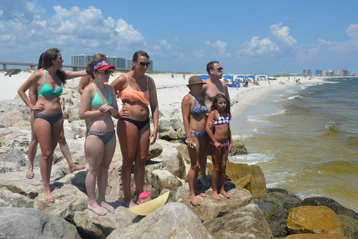 Shark swarm shuts down Gulf Coast beach Beach goers were forced out of the water as 100 sharks swarmed the beaches around the Florida-Alabama state line in early June.