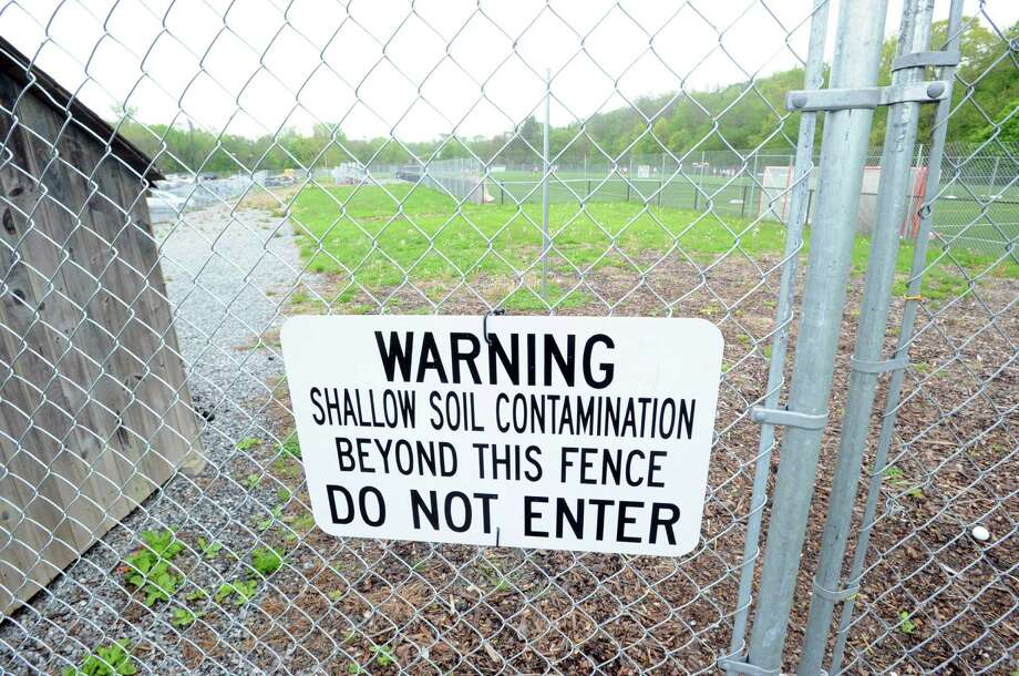 "A sign attached to a fenced-in area near an athletic field reads ""Warning, shallow soil contamination beyond this fence, Do Not Enter,"" at Greenwich High School, Wednesday, May 8, 2013. Photo: Bob Luckey / Greenwich Time"