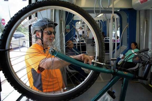 Bob Falcon leans on his bike as he rides the North line of the METRO rail, Monday, June 16, 2014, in Houston. Falcon has lived in Houston 30 years and has welcomed the North line.