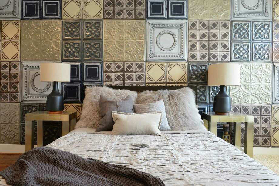 Designer Nina Magon faux-finished tin tiles in mismatched patterns to create a one-of-a-kind mural in the master bedroom. Photo: Michael Hunter Photography / ONLINE_YES