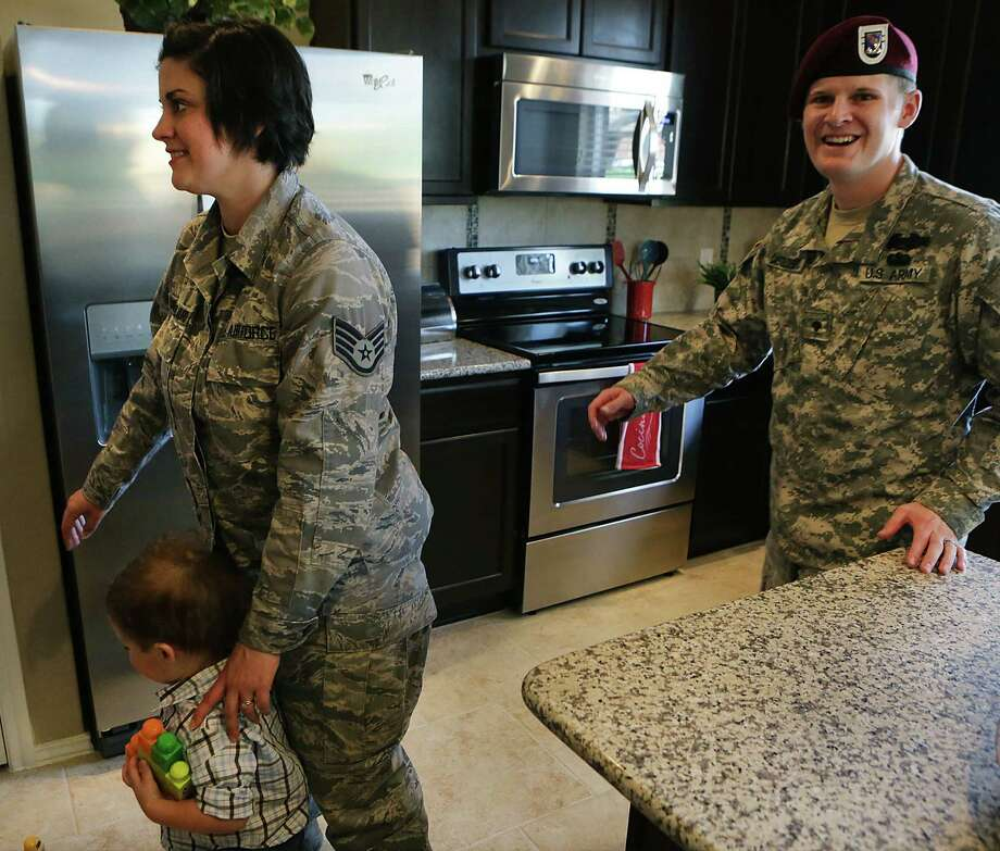 Matthew Castillo del Muro, right, and his wife Kalyn check out their home, one of two provided to families of an injured vet. Photo: Bob Owen/ San Antonio Express-News / © 2012 San Antonio Express-News
