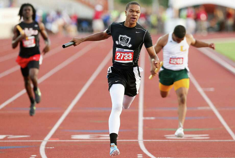 Andrew Hudson finishes the 800-meter relay at state. Photo: Marvin Pfeiffer/ Northeast Herald / Express-News 2014