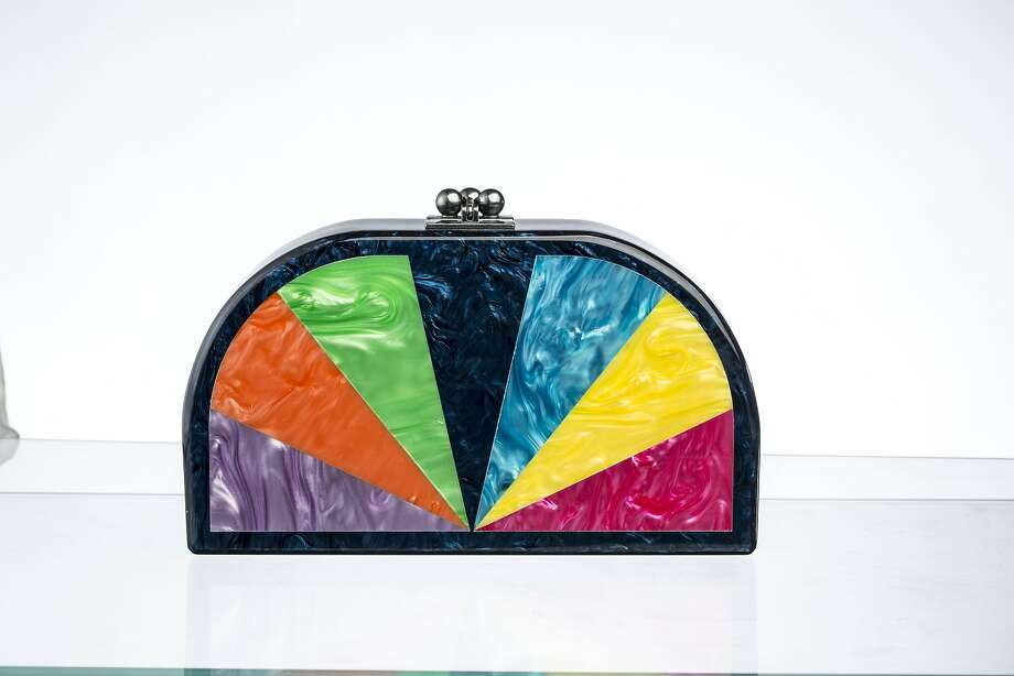 The line of Edie Parker acrylic clutch purses took on a whimsical bent with rainbows for spring-summer. This model, called Dottie (oval with rainbow wedges), retails for $1,295 at  www.edie-parker.com. Photo: Courtesy Of Edie Parker