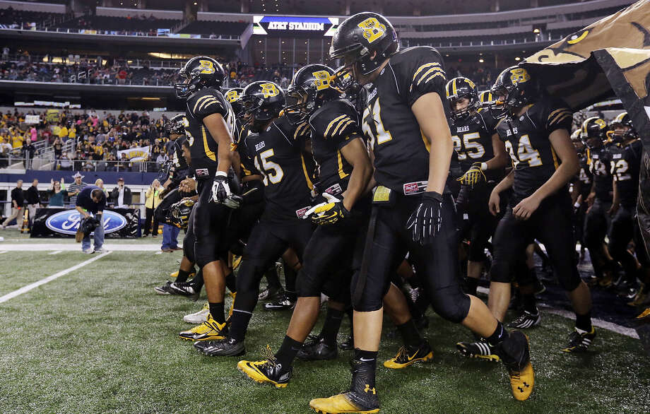 The Brennan Bears take the field at the Class 4A Division I state championship Dec. 20. Photo: Tom Reel / San Antonio Express-News / © 2013 San Antonio Express-News