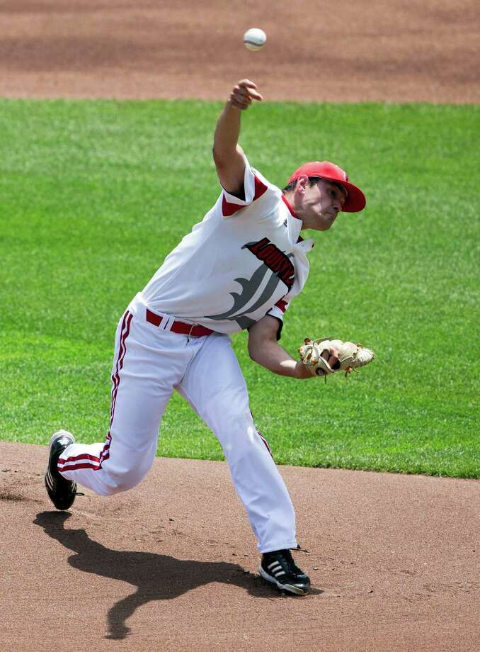Louisville starting pitcher Anthony Kidston delivers against Texas in the first inning of an NCAA baseball College World Series elimination game, Monday, June 16, 2014, in Omaha, Neb. (AP Photo/Nati Harnik) Photo: Nati Harnik, Associated Press / AP