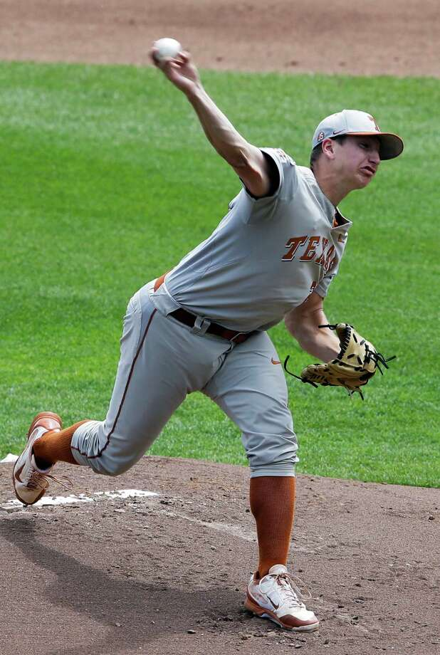 Texas starting pitcher Parker French works against Louisville in the first inning of an NCAA baseball College World Series elimination game in Omaha, Neb., Monday, June 16, 2014. (AP Photo/Nati Harnik) Photo: Nati Harnik, Associated Press / AP