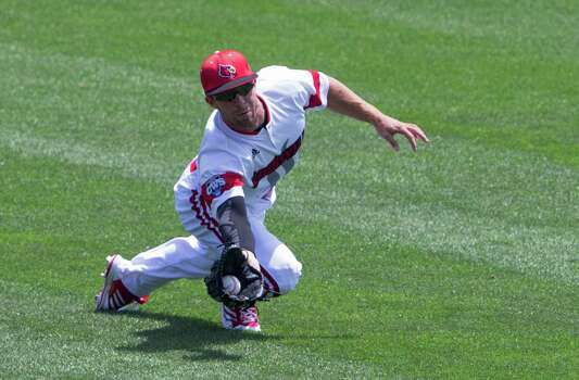 Louisville center fielder Cole Sturgeon catches a fly ball hit by Texas' Brooks Marlow in the first inning of an NCAA baseball College World Series elimination game, Monday, June 16, 2014, in Omaha, Neb. (AP Photo/Nati Harnik) Photo: Nati Harnik, Associated Press / AP