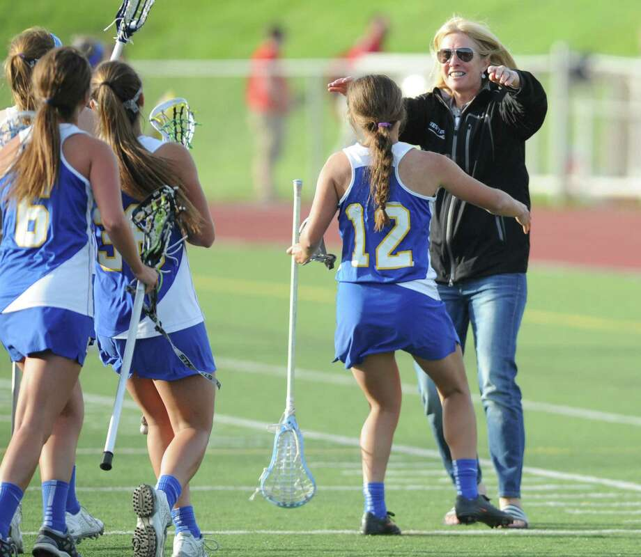 Newtown's Lindsay Jagoe (12) and others run to hug their coach, Maura Fletcher, after their team's 12-8 win over Brookfield in the high school girls lacrosse SWC Division 1 Championship game at Pomperaug High School in Southbury, Conn. Thursday, May 29, 2014. Photo: Tyler Sizemore / The News-Times