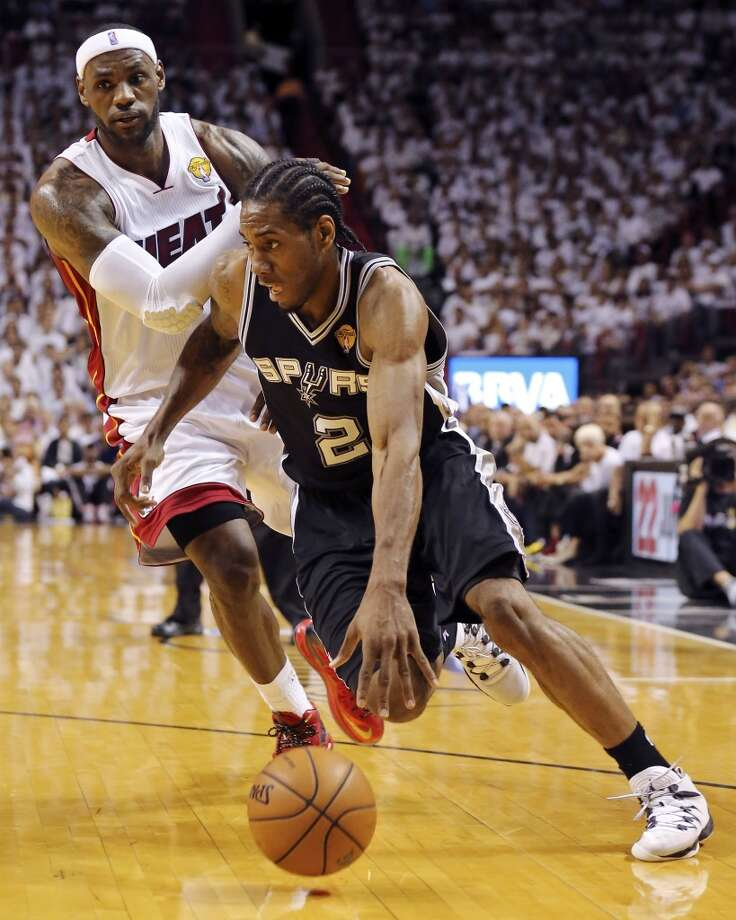 San Antonio Spurs' Kawhi Leonard looks for room around Miami Heat's LeBron James during first half action in Game 3 of the NBA Finals Tuesday June 10, 2014 at American Airlines Arena in Miami, Fla. Photo: Edward A. Ornelas, San Antonio Express-News