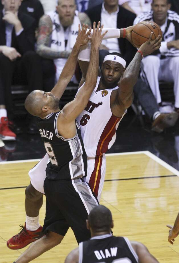 Miami Heat's LeBron James (06) looks to pass against Spurs' Tony Parker (09) in the second half of Game 3 of the 2014 NBA Finals at the American Airlines Arena in Miami on Tuesday, June 10, 2014. (Kin Man Hui/San Antonio Express-News) Photo: Kin Man Hui, San Antonio Express-News
