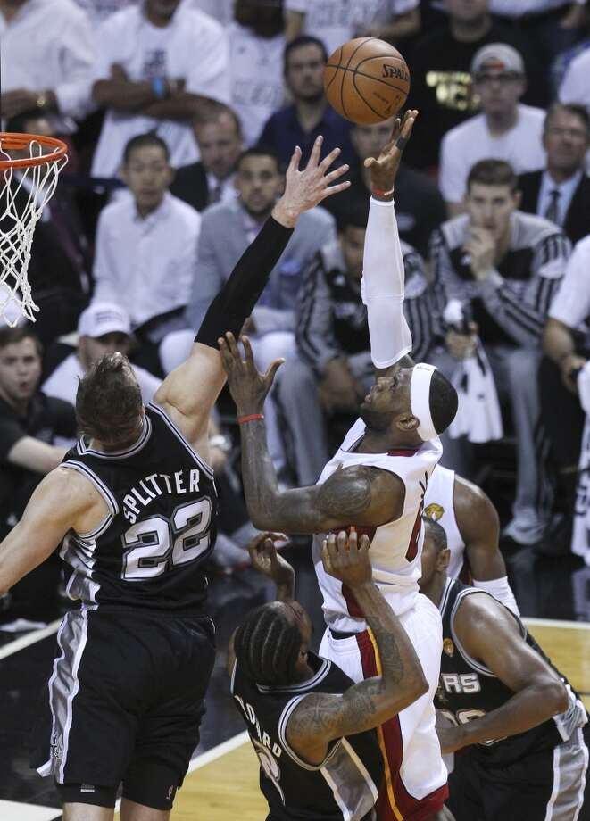 Miami Heat's LeBron James (06) takes a shot against Spurs' Tiago Splitter (22) in the first half of Game 3 of the 2014 NBA Finals at the American Airlines Arena in Miami on Tuesday, June 10, 2014. (Kin Man Hui/San Antonio Express-News) Photo: Kin Man Hui, San Antonio Express-News