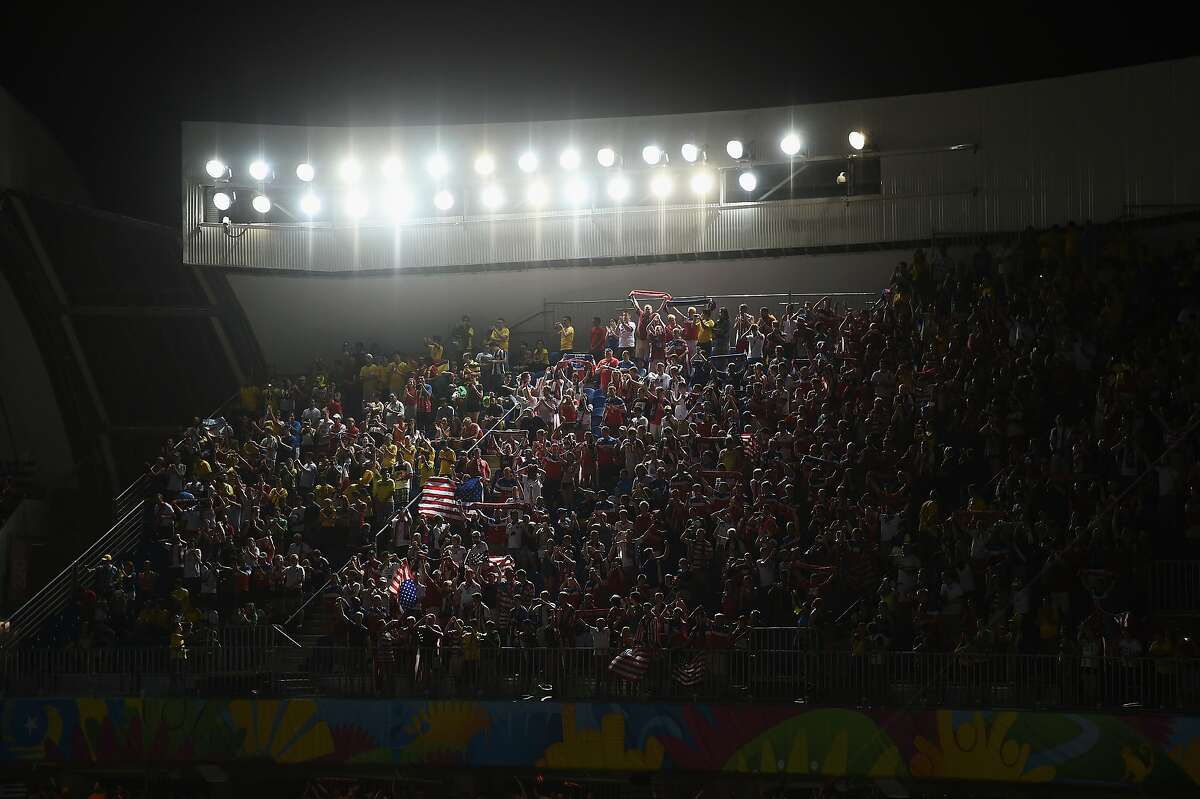 Fans of The United States cheer during the 2014 FIFA World Cup Brazil Group G match between Ghana and the United States at Estadio das Dunas on June 16, 2014 in Natal, Brazil.