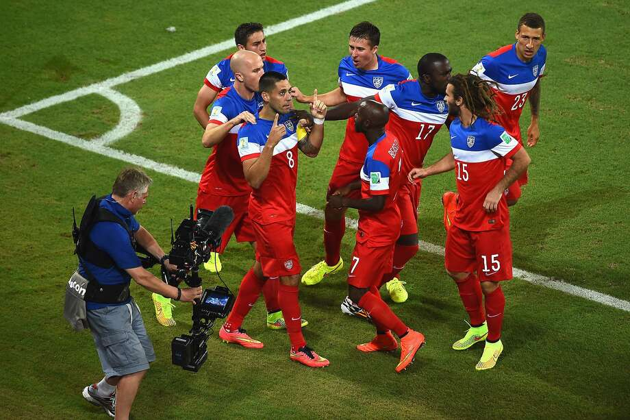 Clint Dempsey of the United States celebrates with teammates after scoring his team's first goal during the 2014 FIFA World Cup Brazil Group G match between Ghana and the United States at Estadio das Dunas on June 16, 2014 in Natal, Brazil.  Photo: Laurence Griffiths, Getty Images
