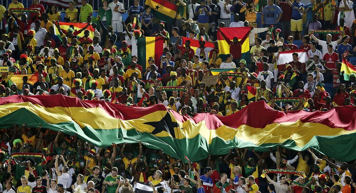 Fans from Ghana unfurl a banner in the stands before the group G World Cup soccer match between Ghana and the United States at the Arena das Dunas in Natal, Brazil, Monday, June 16, 2014.