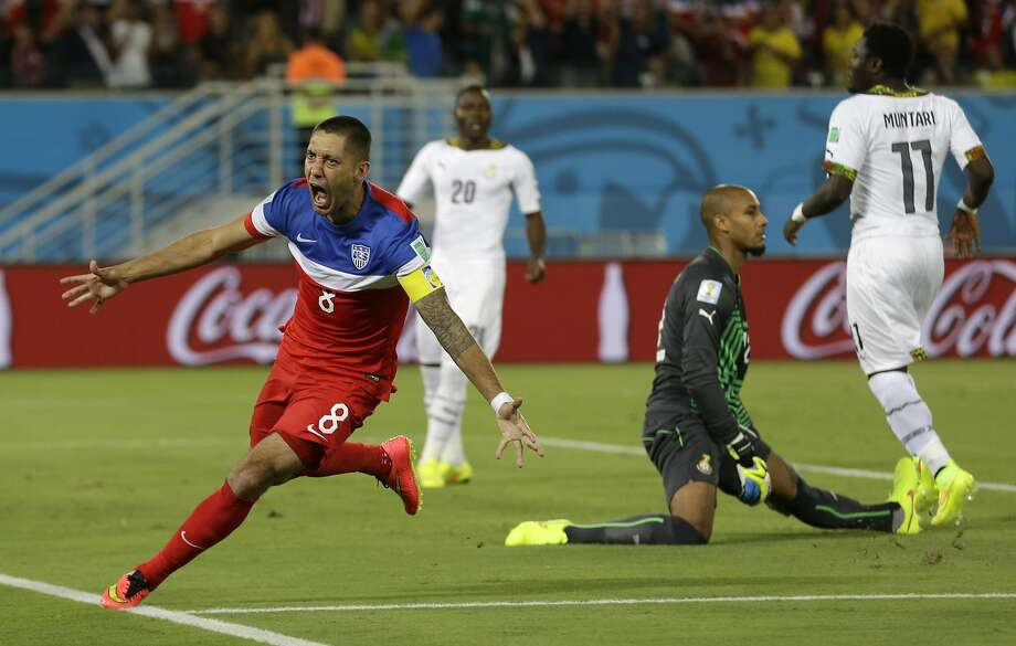 United States' Clint Dempse, left, celebrates after scoring the opening goal during the group G World Cup soccer match between Ghana and the United States at the Arena das Dunas in Natal, Brazil, Monday, June 16, 2014.  (AP Photo/Ricardo Mazalan) Photo: Ricardo Mazalan, Associated Press