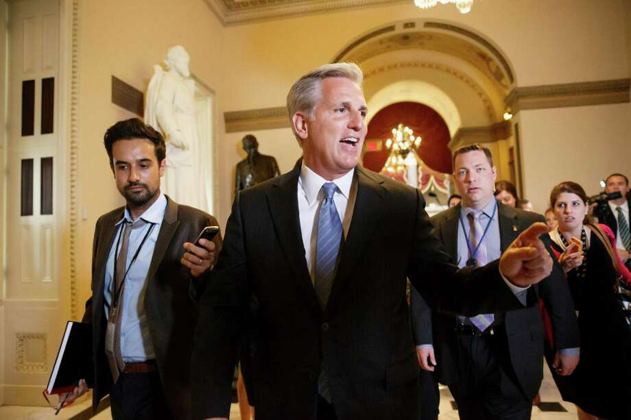 In this photo taken June 11, 2014, House Majority Whip, Republican Kevin McCarthy of Calif., leaves House Speaker John Boehner's office on Capitol Hill in Washington.  Emboldened conservatives are promising to make themselves heard on Capitol Hill like never before in the wake of Majority Leader Eric Cantor's surprise defeat to an unknown with tea party backing. That sets up the potential for struggles over Congress' most basic legislative responsibilities and dooms whatever slim hopes remained for ambitious bills on immigration or voting rights.  (AP Photo/J. Scott Applewhite) Photo: J. Scott Applewhite, STF / AP