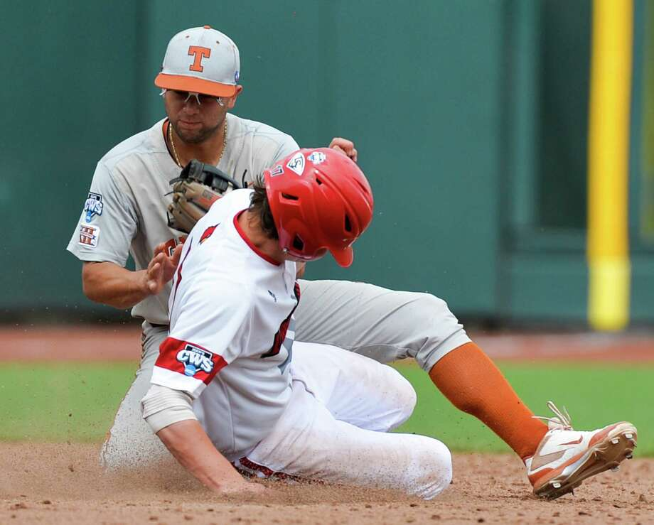 Louisville's Nick Solak, front, steals second base against Texas shortstop C.J Hinojosa, rear, in the sixth inning of an NCAA baseball College World Series elimination game in Omaha, Neb., Monday, June 16, 2014. (AP Photo/Ted Kirk) Photo: Ted Kirk, Associated Press / FR34398 AP