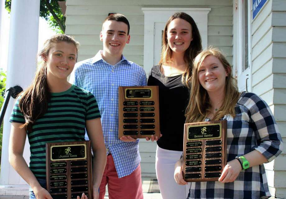 These four Staples High School students were honored for their contributions to SafeRides, the student-run service that provides confidential rides home to teenagers in Westport on Saturday nights. From left are Junior Gem winner Emily Lewis, Executive Board MVPs Bennett Propp and Elizabeth Coogan, and Senior Saviour winner Lea Sellon. Photo: Westport News/Contributed Photo / Westport News