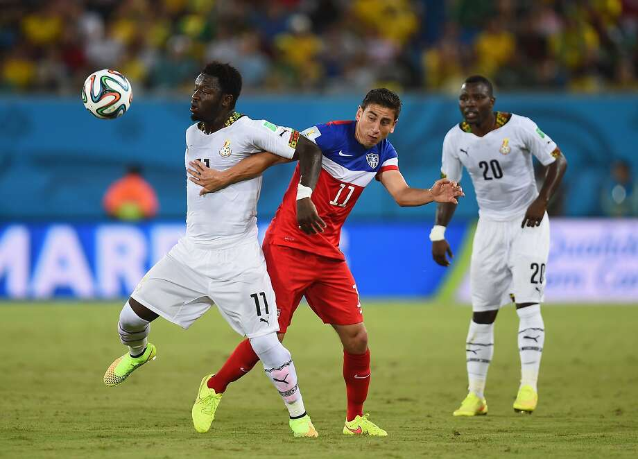 Sulley Muntari of Ghana and Alejandro Bedoya of the United States battle for the ball during the 2014 FIFA World Cup Brazil Group G match between Ghana and the United States at Estadio das Dunas on June 16, 2014 in Natal, Brazil. Photo: Jamie McDonald, Getty Images