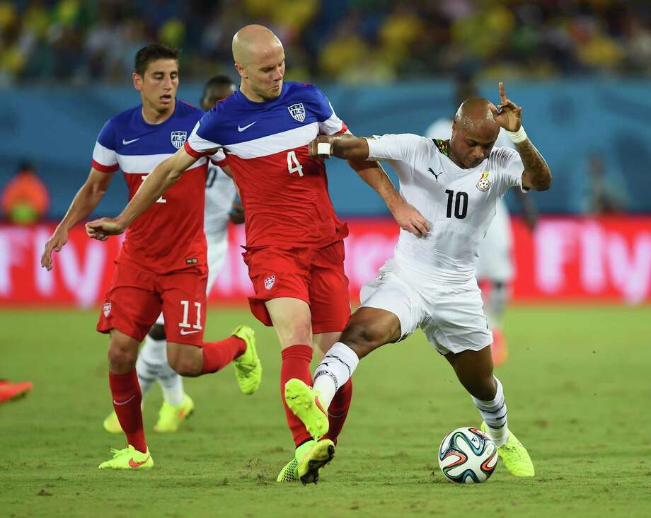 NATAL, BRAZIL - JUNE 16:  Michael Bradley of the United States and Andre Ayew of Ghana battle for the ball during the 2014 FIFA World Cup Brazil Group G match between Ghana and the United States at Estadio das Dunas on June 16, 2014 in Natal, Brazil. Photo: Jamie McDonald, Getty Images / 2014 Getty Images