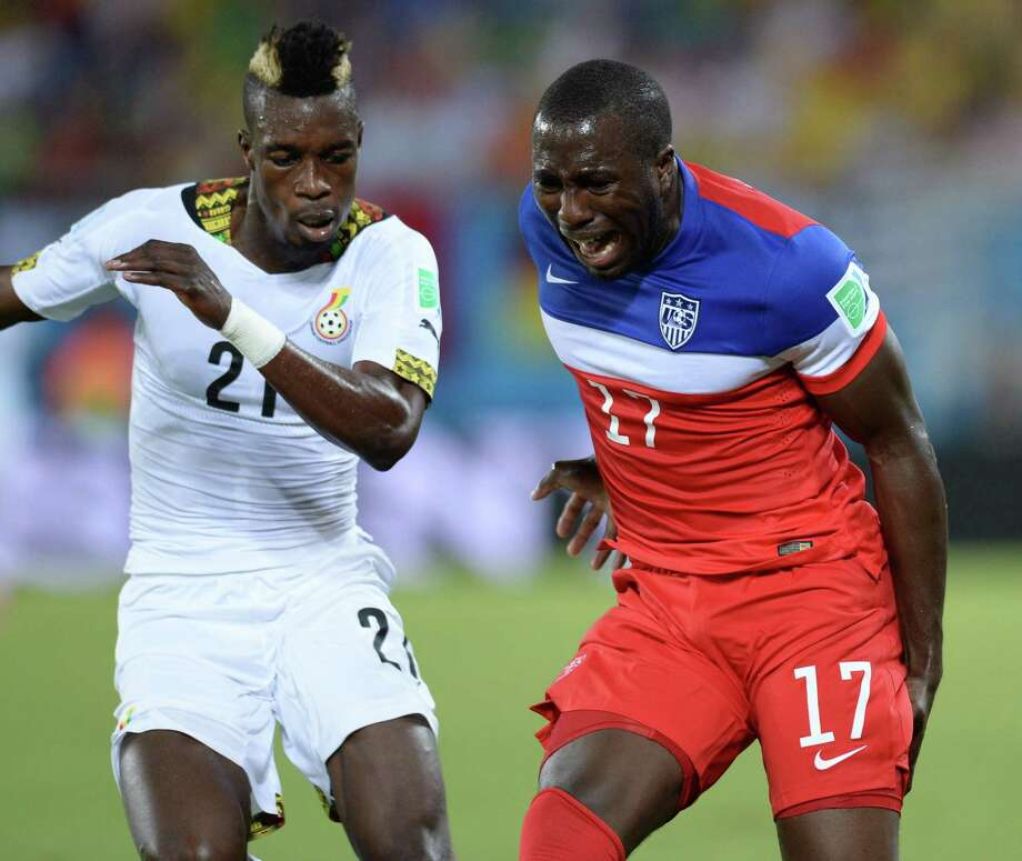 US forward Jozy Altidore (R) gestures in pain next to Ghana's defender John Boye (L) during a Group G football match between Ghana and US at the Dunas Arena in Natal during the 2014 FIFA World Cup on June 16, 2014.   AFP PHOTO / CARL DE SOUZA Photo: CARL DE SOUZA, AFP/Getty Images / AFP