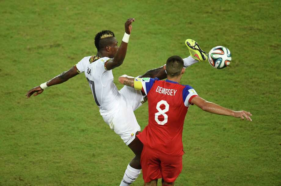 Ghana's defender John Boye (L) vies with US forward Clint Dempsey during a Group G football match between Ghana and US at the Dunas Arena in Natal during the 2014 FIFA World Cup on June 16, 2014.    AFP PHOTO / JAVIER SORIANO Photo: JAVIER SORIANO, AFP/Getty Images / AFP