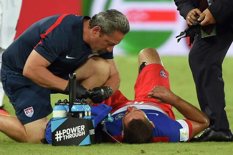 US forward Clint Dempsey (R) receives medical assistance after colliding with Ghana's defender John Boye during a Group G football match between Ghana and US at the Dunas Arena in Natal during the 2014 FIFA World Cup on June 16, 2014.   AFP PHOTO / EMMANUEL DUNAND Photo: EMMANUEL DUNAND, AFP/Getty Images / AFP