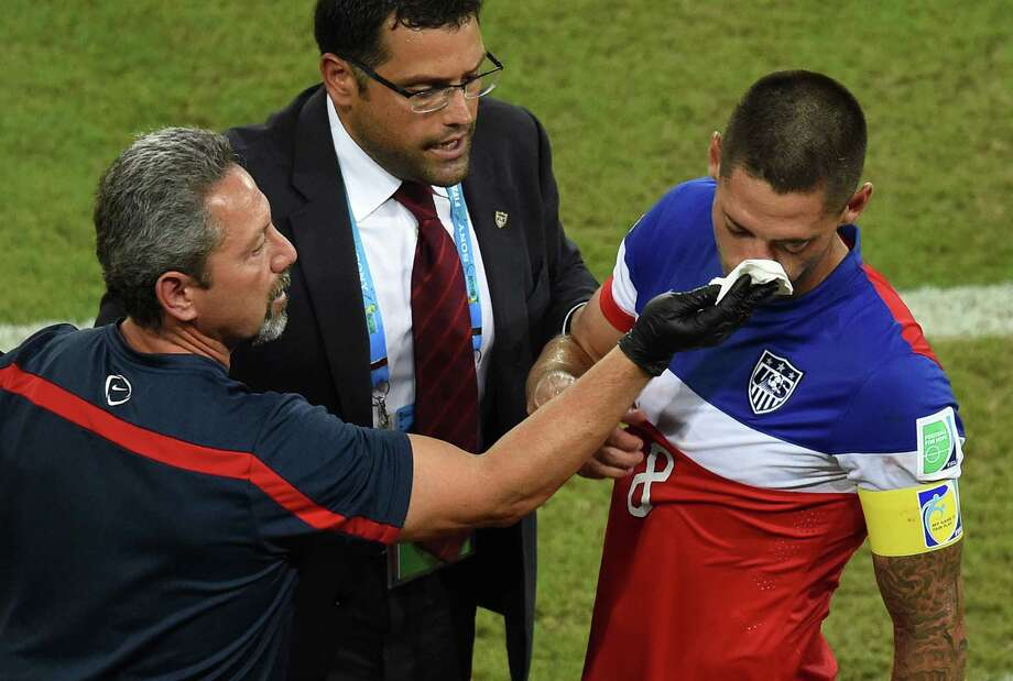 US forward Clint Dempsey (R) receives medical assistance after colliding with Ghana's defender John Boye during a Group G football match between Ghana and US at the Dunas Arena in Natal during the 2014 FIFA World Cup on June 16, 2014.   AFP PHOTO / JAVIER SORIANO Photo: JAVIER SORIANO, AFP/Getty Images / AFP