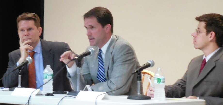 Congressman Jim Himes, center, makes a point during Monday's roundtable discussion on U.S. surveillance and intelligence programs held at the Westport Library. To the left is Mike German, a former FBI agent and currently with the NYU Brennan Center for Justice's Liberty and National Security Program, and, to the far right, is David McGuire of the American Civil Liberties Union of Connecticut. Photo: Anne M. Amato / westport news