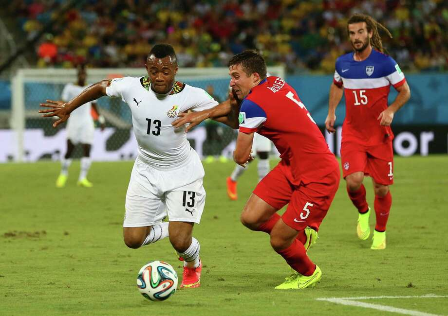 NATAL, BRAZIL - JUNE 16:  Jordan Ayew of Ghana and Matt Besler of the United States battle for the ball during the 2014 FIFA World Cup Brazil Group G match between Ghana and the United States at Estadio das Dunas on June 16, 2014 in Natal, Brazil. Photo: Kevin C. Cox, Getty Images / 2014 Getty Images