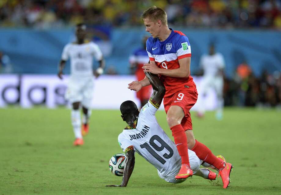 Ghana's defender Jonathan Mensah (L) vies with US forward Aron Johannsson (R) during a Group G football match between Ghana and US at the Dunas Arena in Natal during the 2014 FIFA World Cup on June 16, 2014.   AFP PHOTO / CARL DE SOUZA Photo: CARL DE SOUZA, AFP/Getty Images / AFP