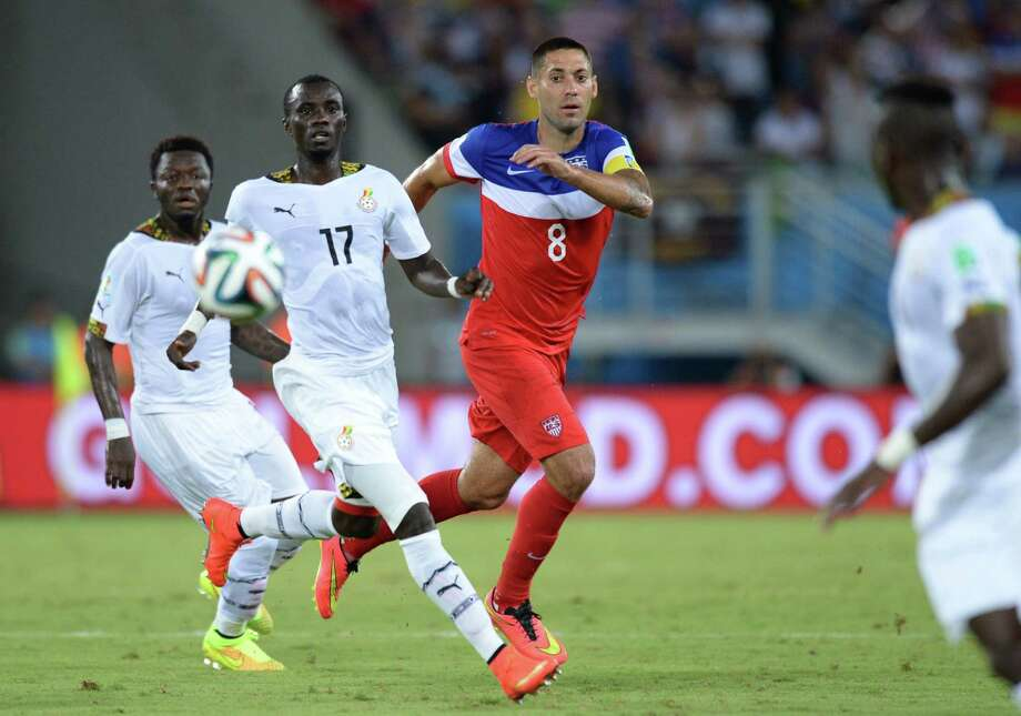 Ghana's midfielder Mohammed Rabiu (C) and US forward Clint Dempsey (R) eye the ball during a Group G football match between Ghana and US at the Dunas Arena in Natal during the 2014 FIFA World Cup on June 16, 2014.   AFP PHOTO / CARL DE SOUZA Photo: CARL DE SOUZA, AFP/Getty Images / AFP