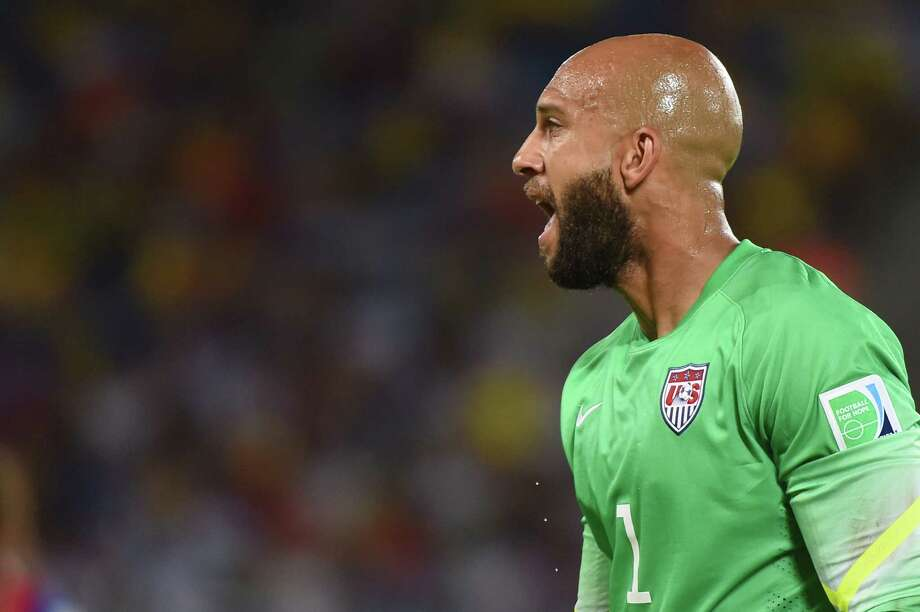 US goalkeeper Tim Howard  reacts during a Group G football match between Ghana and US at the Dunas Arena in Natal during the 2014 FIFA World Cup on June 16, 2014.   AFP PHOTO / EMMANUEL DUNAND Photo: EMMANUEL DUNAND, AFP/Getty Images / AFP