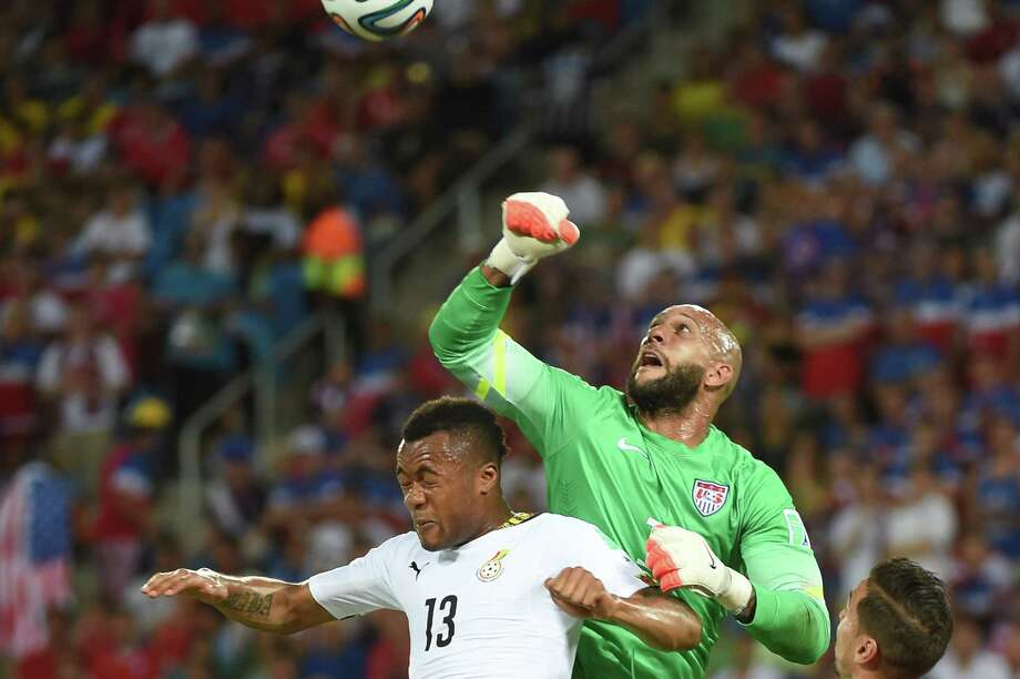 Ghana's forward Jordan Ayew (L) jumps for the ball with US goalkeeper Tim Howard  during a Group G football match between Ghana and US at the Dunas Arena in Natal during the 2014 FIFA World Cup on June 16, 2014.    AFP PHOTO / EMMANUEL DUNAND Photo: EMMANUEL DUNAND, AFP/Getty Images / AFP