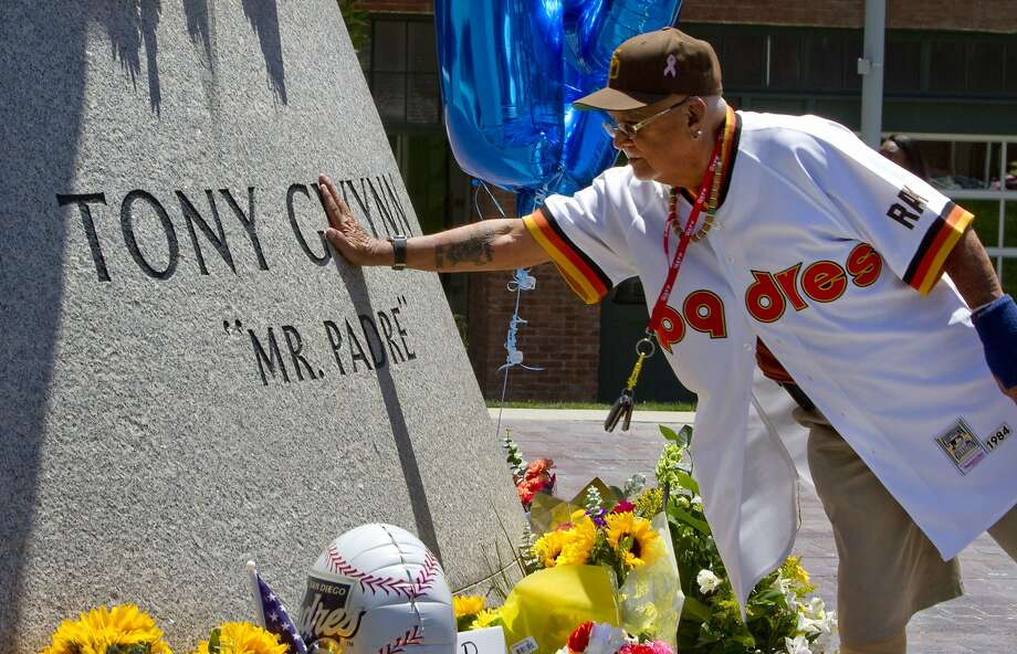 "Lorenzo ""Papa Fred"" Alferos Sr. places his hand on the base of a statue of the late Padres Hall of Famer Tony Gwynn at Petco Park in San Diego. Photo: Bill Wechter, Getty Images"